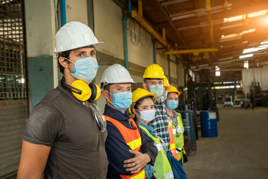 Group technician is ready to work at factory and wear a mask to prevent the disease from Coronavirus Disease 2019 (COVID-19).