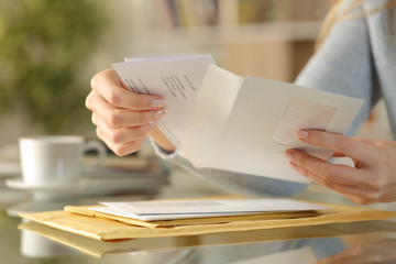 Obraz Girl hands opening an envelope on a desk at home - fototapety do salonu