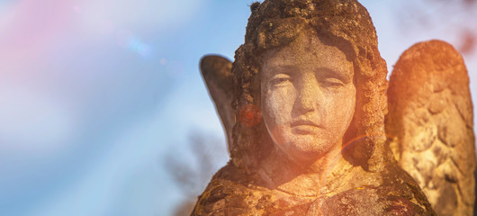 Fotomurales - Beautiful sad angel. Vintage styled image of ancient stone statue. Religion, faith, death, resurrection, eternity concept.