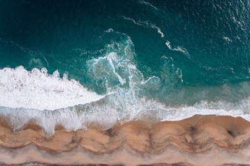View from a drone to a cape and Pacific coast at sunset Wall mural