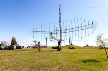 Old soviet military radar station against the blue sky