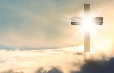 Silhouette of cross against blue sky. Christian religion Fotomurales