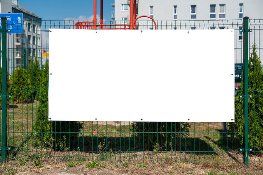 Blank advertising banner mounted on the fence.