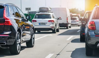 Car rush hours city street. Cars on highway in traffic jam Fotomurales