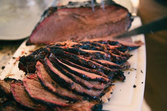 Sliced smoked beef brisket with nice smoke ring.