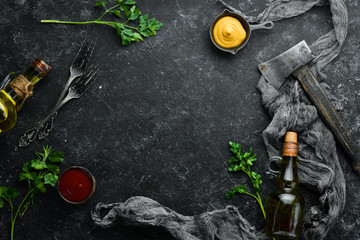 Fototapete - Black stone food background. Cooking. Top view. Free space for your text.