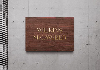 Wooden Gold Sign Logo Mockup on Concrete Wall