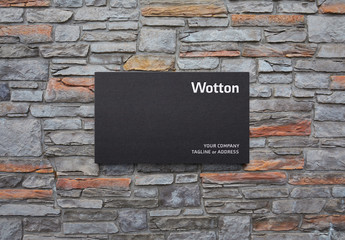 Matte Plastic Logo Sign Mockup on Stone Wall