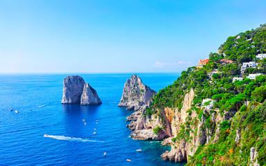 Ships near Faraglioni cliffs and Tyrrhenian Sea on Capri Island reflex Wall mural
