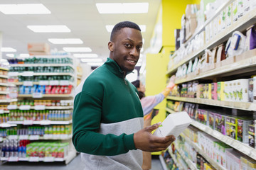 Portrait man shopping in supermarket