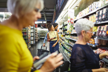 Women grocery shopping in supermarket