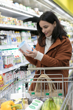 Woman grocery shopping in supermarket