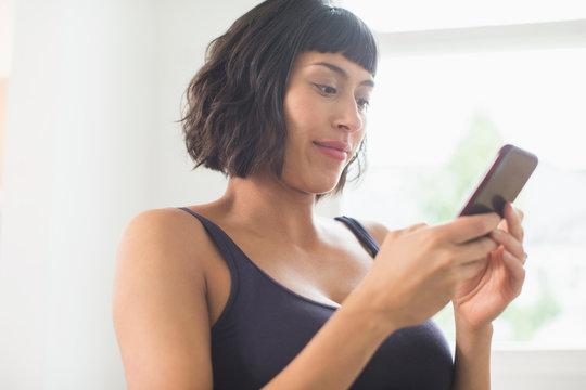 Woman in bra using smart phone