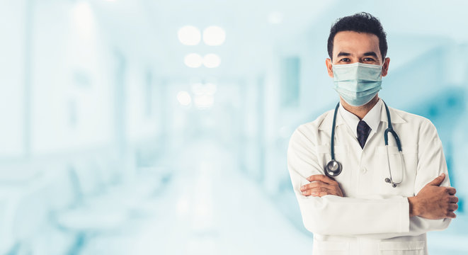 Doctor at hospital wearing medical mask to protect against coronavirus 2019