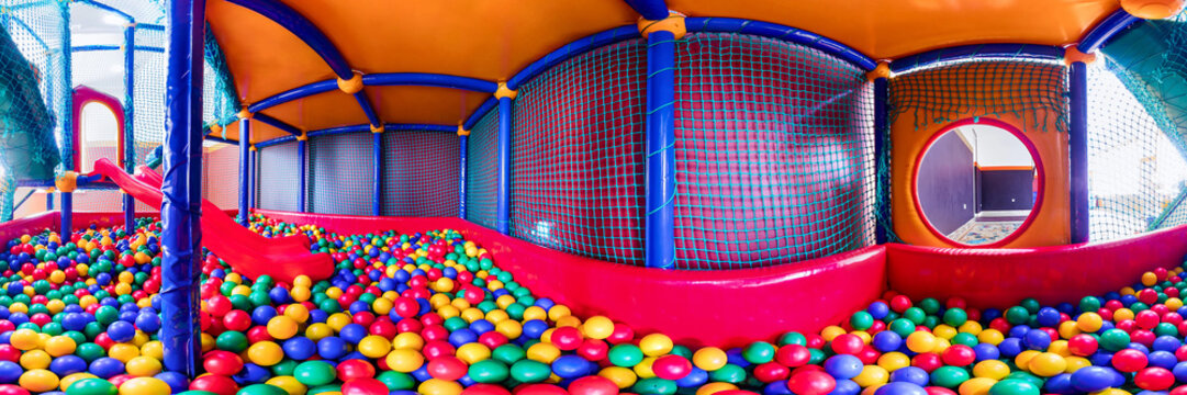 children's playroom with colorful balls and a slide made of plastic. . Cylindrical panorama 360
