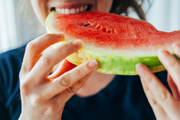 young adult woman eating watermelon fruit