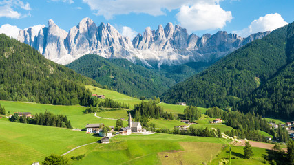 Beautiful dolomite rocks and village on a sunny day in Northern Italy