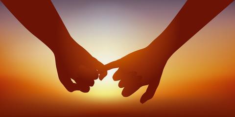 Concept du sentiment amoureux avec un couple qui se donne la main en signe d'union.