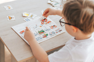 The child is studying at home, English learning with cards, educational games for children,...