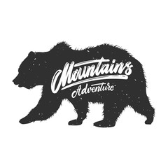 Mountains adventure. Silhouette of grizzly bear on grunge background. Design element for poster, card, banner, sign.
