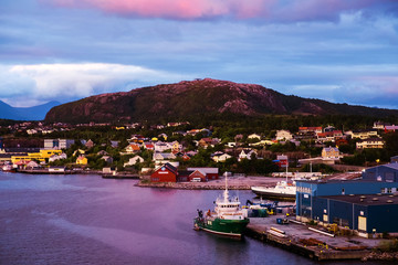 Wall Mural - View of city center of Kristiansund, Norway during the cloudy morning at sunrise