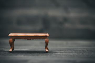 Old vintage antique table on black wooden background
