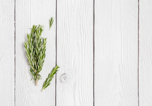 rosemary copy space on white wood