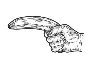 Male hand shoots a banana. Sketch scratch board imitation.
