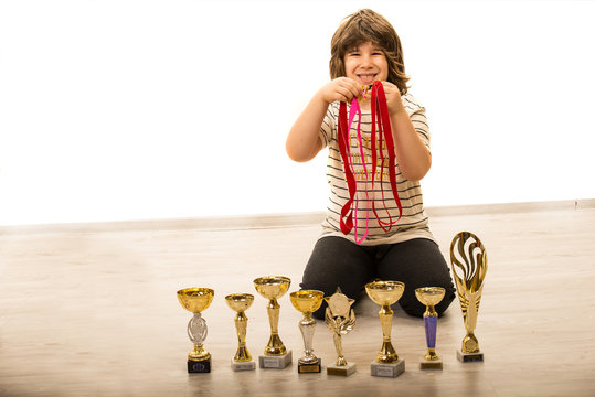 Proud boy of his medals and trophies