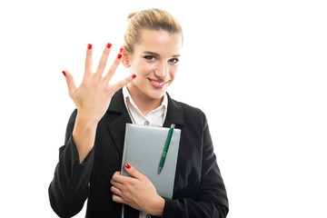 Young female assistant manager holding agenda showing number five