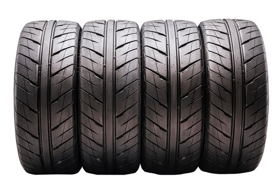 nice summer tires, four pieces set in a row. pour, white background