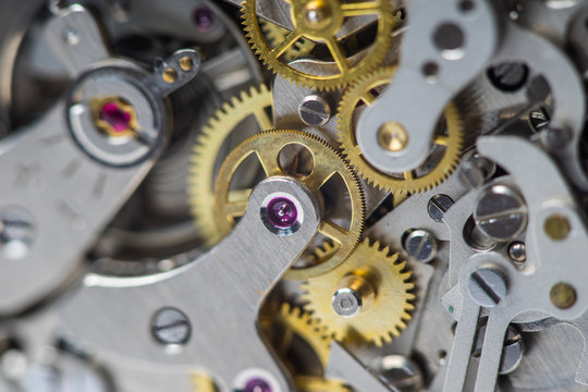 Macro close-up of complex watch movement parts. Focus on the ruby jewel.