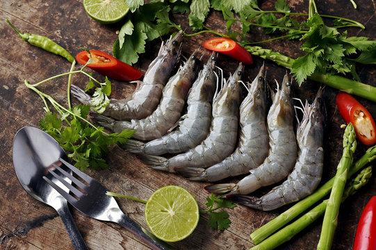 fresh prawn or shrimp on butcher with vegetable