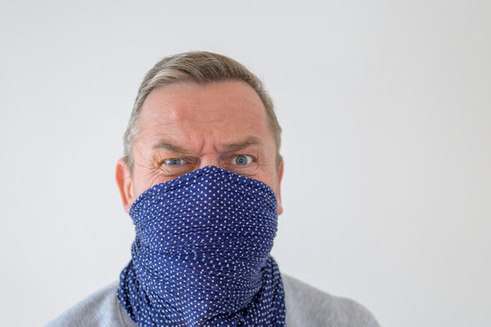 Middle-aged man in blue wrap with anxious look