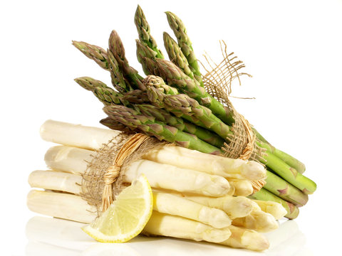 Green and White Asparagus Bundles with Lemon on white Background