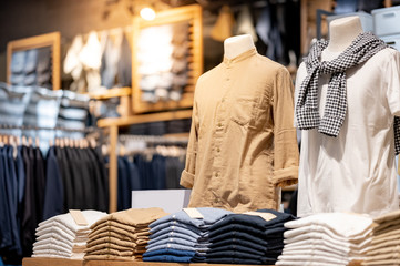 Trendy cotton Men shirt display on mannequin in clothes shop. Summer collection fashion product samples in clothing store for selling. Textile industry and business concept Wall mural