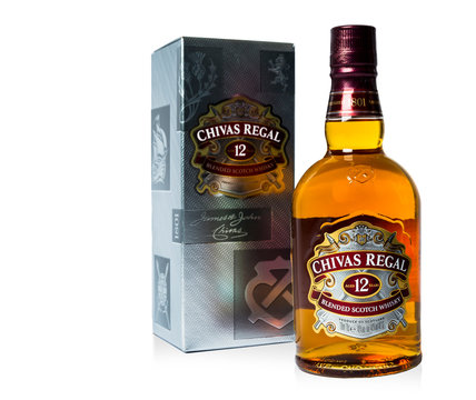 Saint-Petersburg, Russia - 26 August 2017: Studio shot of a bottle of Chivas Regal on white background, 12 years old scotch whiskey.Chivas Regal is a blended Scotch whisky produced by Chivas Brothers