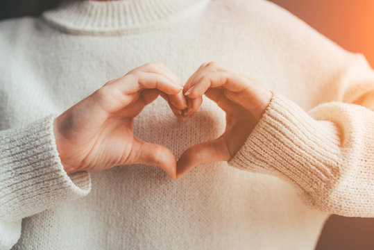 Female hands in the form of heart. Love and care concept.