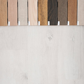 Samples of wooden skirting boards for different types of floors. Interior Design. Repair and construction of the house. Copy space.