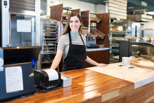 Entrepreneur standing in bakery shop counter