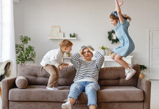 Senior woman with grandchildren at home.