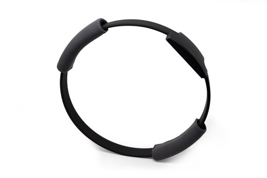A grey exercise ring to stay fit. Device used with videogame controllers.