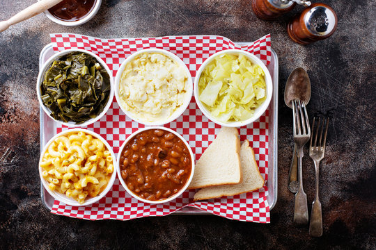 Classic southern bbq sides with beans, cole slaw, mac and cheese and collard greens