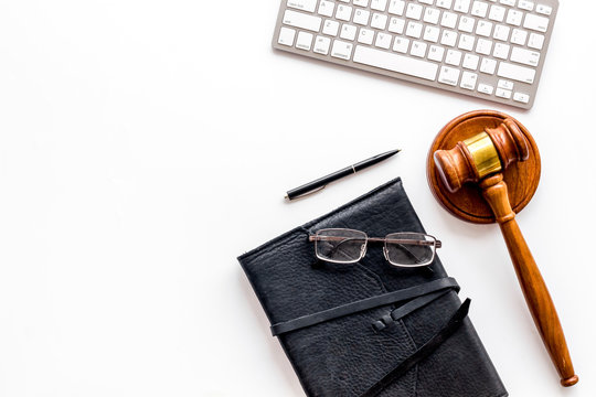 Judge gavel near documents and keyboard - desk of contemporary lawyer - on white background top-down copy space