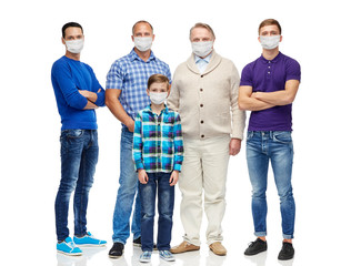 health, quarantine and pandemic concept - group of men and boy wearing protective medical masks for...