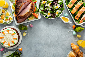 Big traditional Easter brunch with ham, quiche lorraine and carrot cake and copy space for text