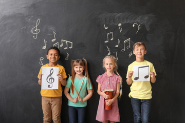 Little children near chalkboard at music school