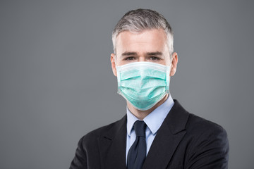 Businessman in suit wearing a face mask