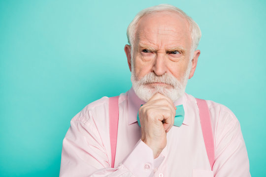 Close up photo of pensive minded old man look copyspace think thoughts want decide decisions solutions wear stylish shirt isolated over turquoise color background