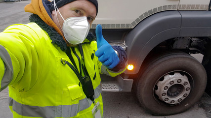 young transporter on the truck with face mask and protective gloves for Coronavirus Wall mural